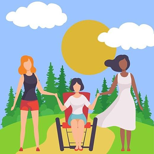 Three people in a park. A white woman, A person using a wheelchair, and a black woman